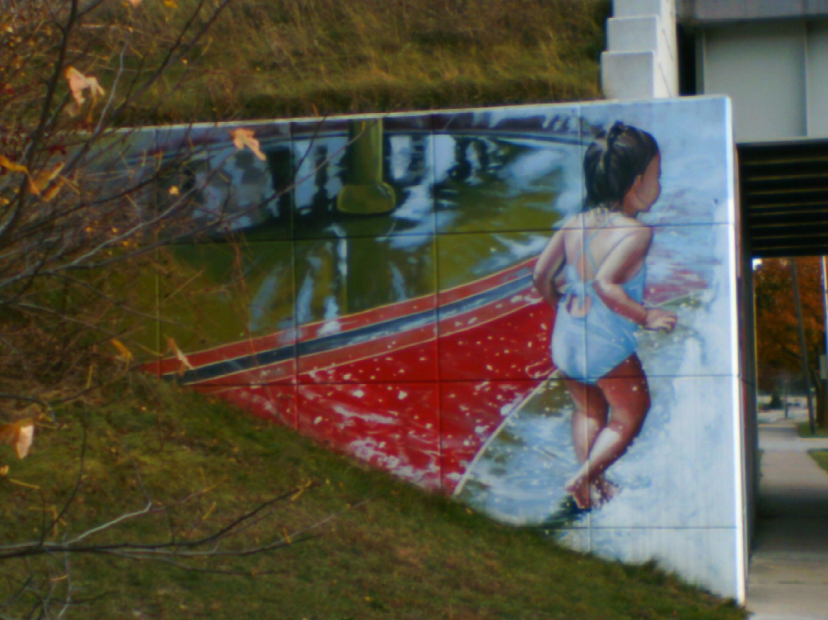 Girl playing at the Poseyville overpass.