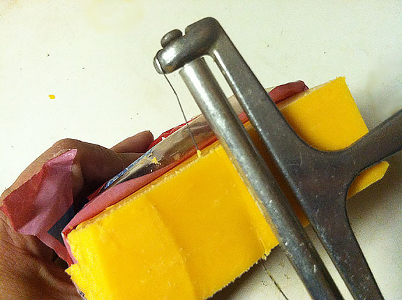 a block of cheese being sliced