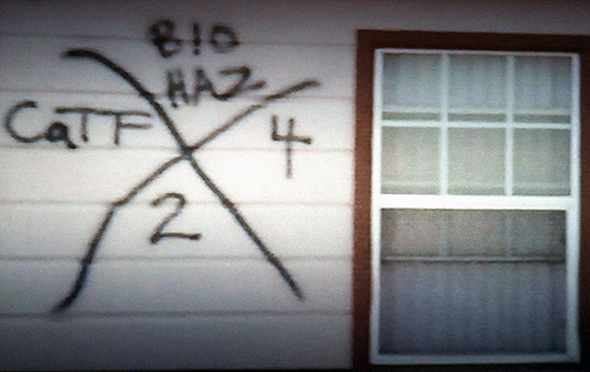 TV SCREENSHOT: When the government is painting signs like this on your neighbors' homes, you should try to leave.
