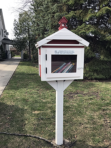 Little Library on a wooden post in Bay City, Michigan